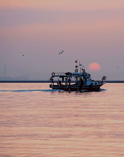 Fishingboat Water Sea Sky Nautical Vessel Transportation Sunset Beauty In Nature Scenics - Nature Mode Of Transportation Nature Outdoors No People Horizon Over Water Travel Seascape Day Architecture Built Structure