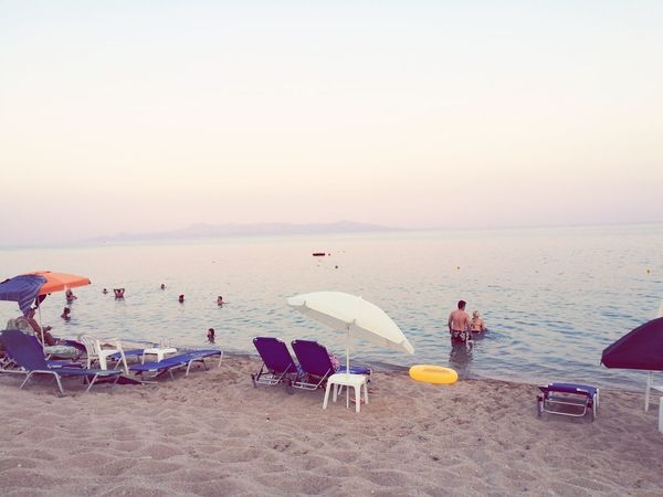 Beach Sand Sea Water Outdoor Chair Sky Sunset Chair Horizon Over Water Outdoors Tranquility Nature Summer Relaxation People Adult Vacations Beauty In Nature Day One Person First Eyeem Photo