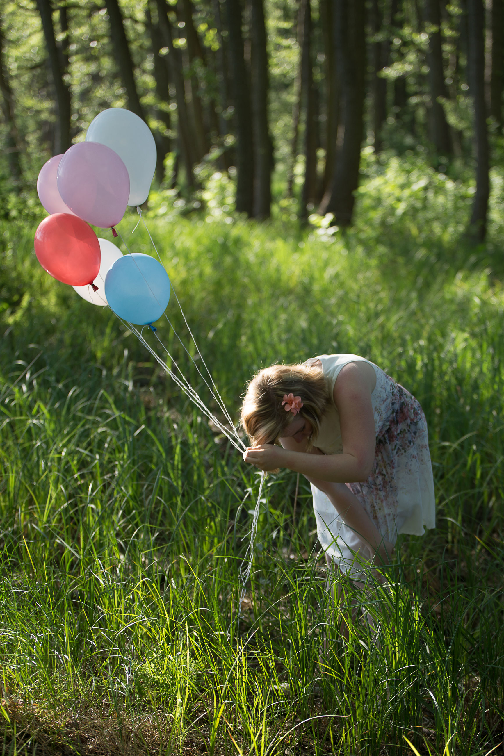 plant, land, grass, nature, balloon, field, women, real people, one person, day, lifestyles, tree, girls, females, leisure activity, side view, three quarter length, green color, helium balloon, outdoors, hairstyle
