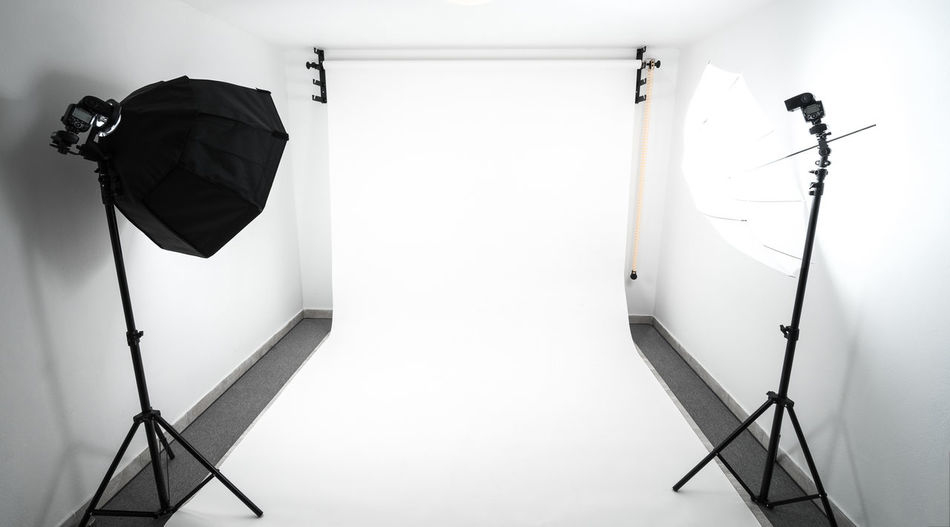 Amateur home made photo studio in the basement. Inexpensive Self made background in the photo studio. Amateur Backdrop Background Equipment Film Industry Film Studio Flash Home Illuminated Indoors  Lighting Equipment No People Photography Photography Studio Preparation  Softbox Strobe Studio Studio The Media Umbrella White