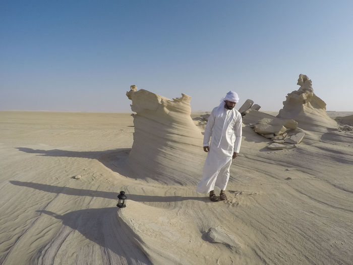Abudhabi Adult Adults Only Arabic Style Arid Climate Clear Sky Day Desert Eid Eid Mubarak Full Length Landscape Nature One Man Only One Person Outdoors People Ramadan  Real People Sand Sand Dune Shadow Sky Traditional Clothing