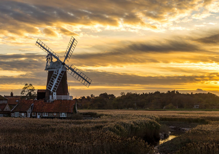 Cley Windmill, Norfolk, England Cley Windmill Norfolk Uk Alternative Energy Architecture Beauty In Nature Cloud - Sky Environmental Conservation Field Grass Landscape Nature No People Orange Color Outdoors Renewable Energy Rural Scene Scenics Sky Sunset Traditional Windmill Tranquil Scene Tranquility Wind Power Wind Turbine Windmill First Eyeem Photo