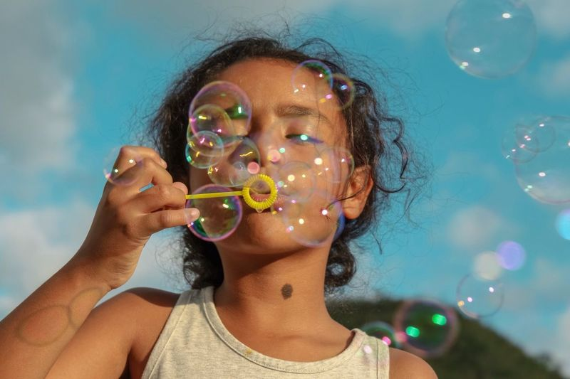 Blowing Bubbles Headshot Bubble Portrait One Person Blowing Leisure Activity Bubble Wand Front View Childhood Fun Happiness Fragility Vulnerability  Girls Hair 2018 In One Photograph Moments Of Happiness My Best Photo