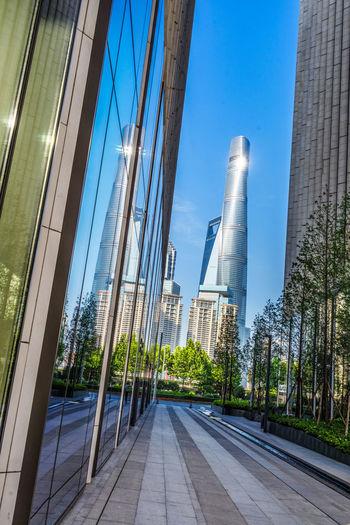 Modern city against clear blue sky