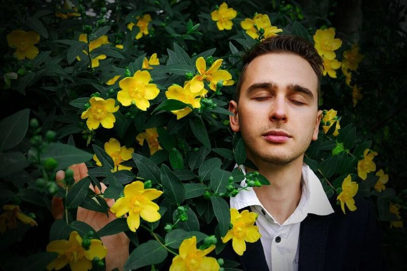 Nature is our love. Feeling it through. Showcase July Portrait Man Flower Scenery Nature Day Natural Beauty Natural Light Portrait Leaves Postprocessing Yellow Green Boy Portrait Of A Friend Portrait Photography Portraits Feeling Love
