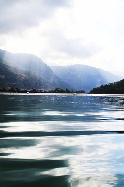 Lagoon Mountain Water Scenics Tranquil Scene Mountain Range Tranquility Beauty In Nature Lake Sky Nature Idyllic Cloud - Sky Majestic Waterfront Non-urban Scene Day Outdoors Remote Water Surface No People Oludeniz The Great Outdoors - 2017 EyeEm Awards