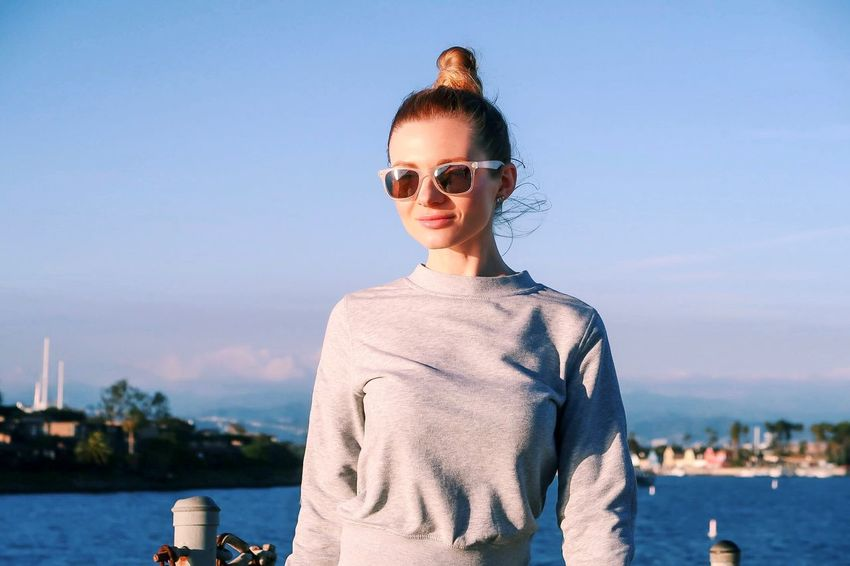 Sky Water Glasses Sunglasses One Person Real People Fashion Young Adult Leisure Activity Front View Portrait Standing Sunlight Outdoors Beautiful Woman Women