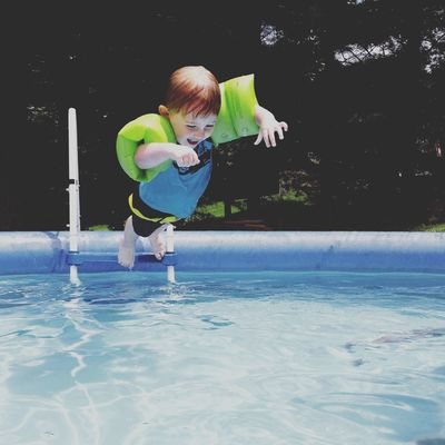 Water Swimming Pool One Person People Full Length Child Blond Hair Blue Outdoors Real People Swimming Fun