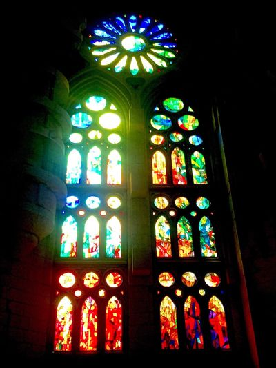 A stained glass window Inside the Segrada Familia Stained Glass Church Religion Window Spirituality Religion Place Of Worship Multi Colored Art Religion Indoors  Colorful Bright Vibrant Color Art Product Back Lit Lit Geometric Shape