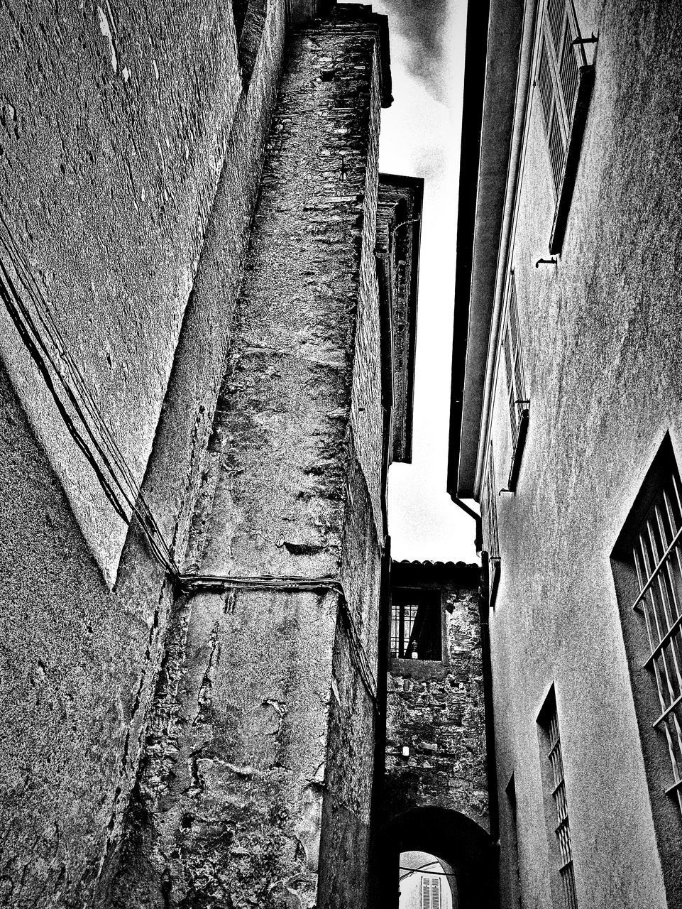 LOW ANGLE VIEW OF OLD BUILDINGS AGAINST WALL