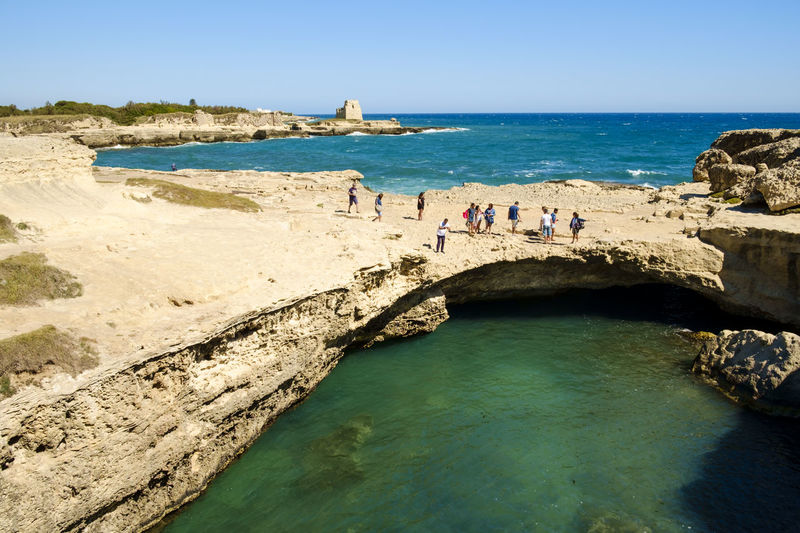 Architecture Beach Beauty In Nature Blue Built Structure Day Grotta Della Poesia Horizon Over Water Italy Large Group Of People Lecce Leisure Activity Melendugno Outdoors Puglia Real People Rock - Object Salento Salento, Italy Scenics Sea Sky Sunlight Travel Destinations Water