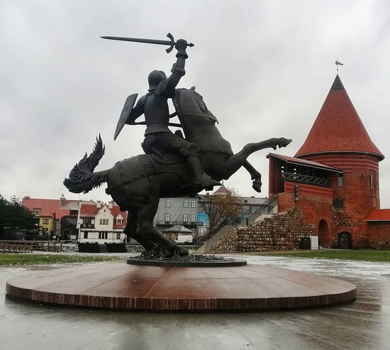 Kaunas castle City King - Royal Person Statue Sculpture Arts Culture And Entertainment History Place Of Worship Religion Cityscape Sky Monument National Monument Castle Medieval Fortified Wall Fort Knight - Person Fortress