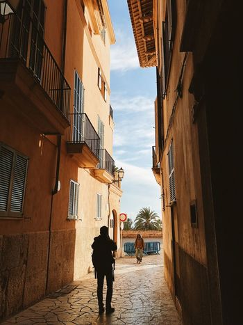 Palma de Mallorca, Spain Exploring Mediterranean  Palma De Mallorca SPAIN Silhouette Traveling Alley Architecture Blue Sky Building Building Exterior Built Structure Day Gap Between Buildings Lifestyles Light And Shadow Men Outdoors Residential District Street The Way Forward Two People Walking