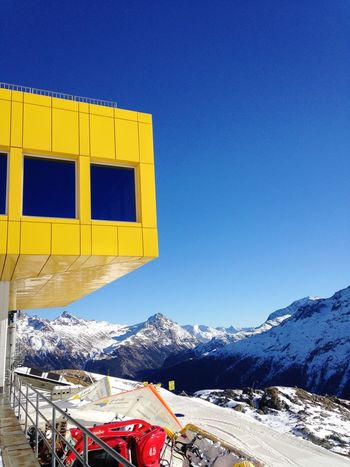 Lunch in Corviglia (2486 m) 💙💛 Snow Winter Mountain Snowcapped Mountain Outdoors Scenics Building Exterior Mountain Range No People Day Vacations Sky Ski Holiday Corviglia Restaurant Contrasting Colors Yellow Blue January St Moritz Switzerland My Photography Ski Resort  Architecture Design