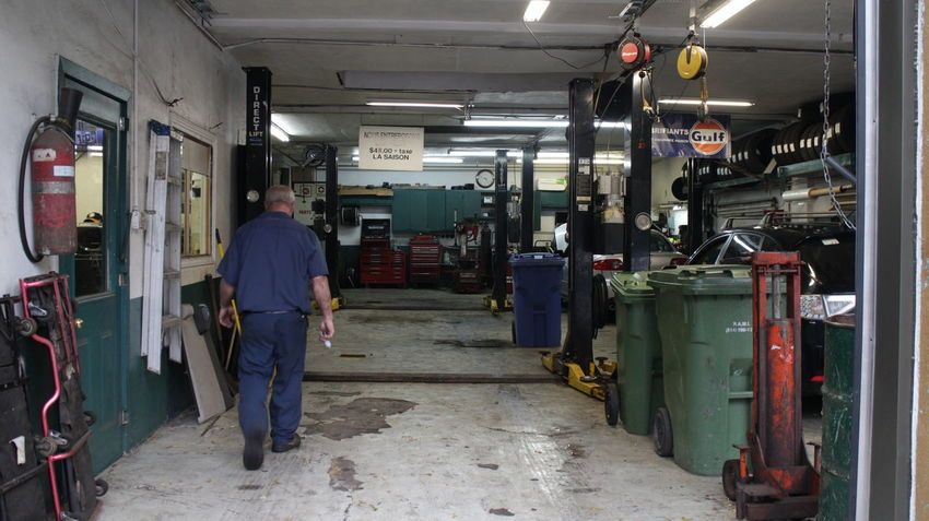 Photos taken in and around Montreal in the fall of 2018 Montréal City City Life Garage Mechanic Machinery Tools Occupation Rear View One Person Working Men Standing Architecture Business Industry Illuminated Lighting Equipment Walking Factory Production Line Adult Real People
