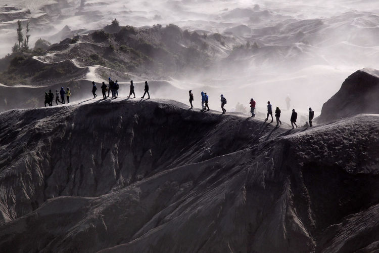 People Hiking On Mountain