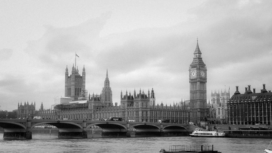 Westminster bridge over thames river against sky