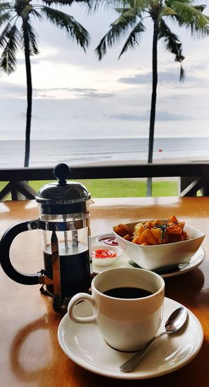 Coffee time Coffee Coffee - Drink Palm Tree Food Sea Outdoors Bali Island No People Samsungphotography Day Coffee And Sweets Black Coffee Coffee Cup Hot Drink Caffeine