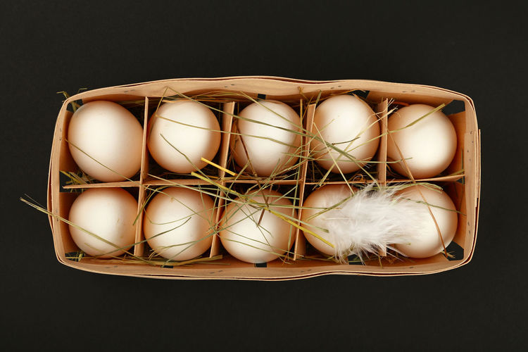 White organic chiken eggs in natural wooden carrier crate with hay Egg Container Food High Angle View White Color Eggs Box Box - Container Conteiner White Eggs Hay Organic Organic Food Fresh Cuisine Homegrown Holder Ingredient Natural Black Background Freshness Healthy Eating Group Of Objects Close-up