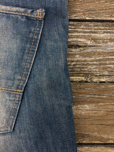 High Angle View Of Jeans On Wooden Table