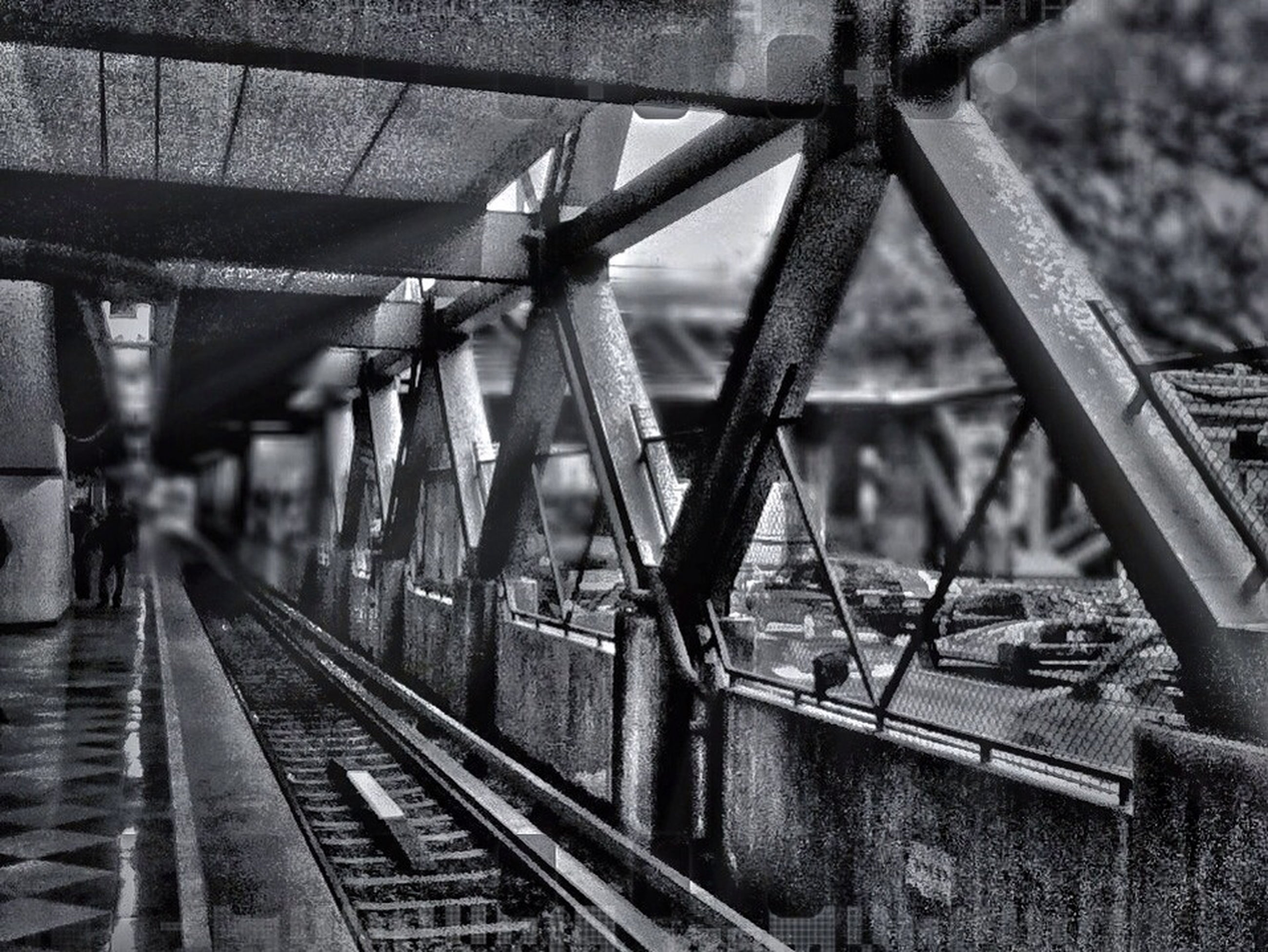 architecture, built structure, railroad track, the way forward, metal, transportation, railing, diminishing perspective, rail transportation, indoors, bridge - man made structure, connection, vanishing point, architectural column, ceiling, travel, metallic, day, incidental people, steps