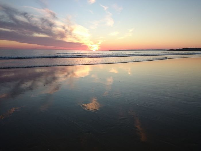 Sunset Reflection Sea Cloud - Sky Water Sky Outdoors Beauty In Nature Beach Nature Horizon Over Water Dramatic Sky No People Scenics Sun Day