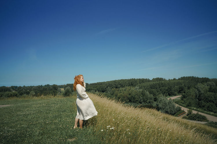 Full length of woman on field against sky
