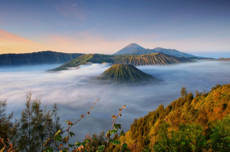 Mount Bromo, or bromo volcano at sunrise, Tengger Semeru National Park, East Java, indonesia. Mount Bromo Tengger Semeru National Park East Java Nature Sunrise Sunset Sky And Clouds Amazing View Landscape Ilovephotography Ilovenature Wallpaper Blue Sky Travel Backpacking Bromo Tengger Semeru National Park Beautiful Sunrise Scenic Landscapes Scenery Peak INDONESIA