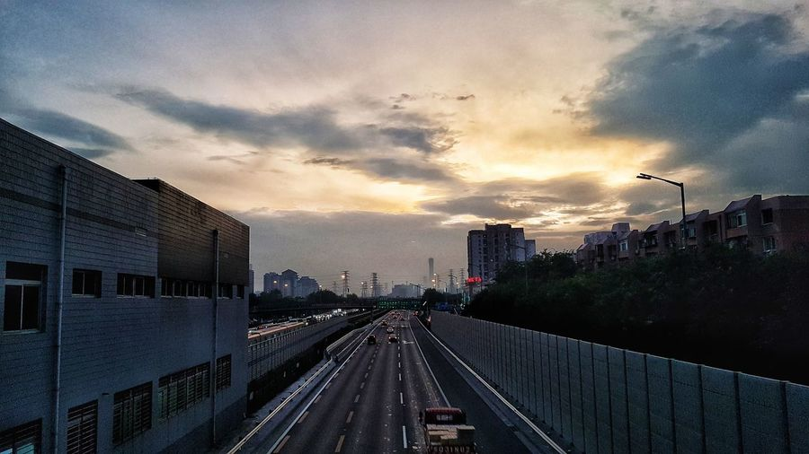 Cloud - Sky No People Outdoors Sky City Sunset Day Train - Vehicle Architecture Railroad Track Rail Transportation Built Structure Transportation Illuminated Building Exterior