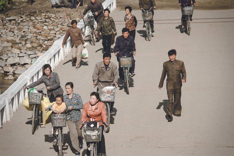 High angle view of people standing on road