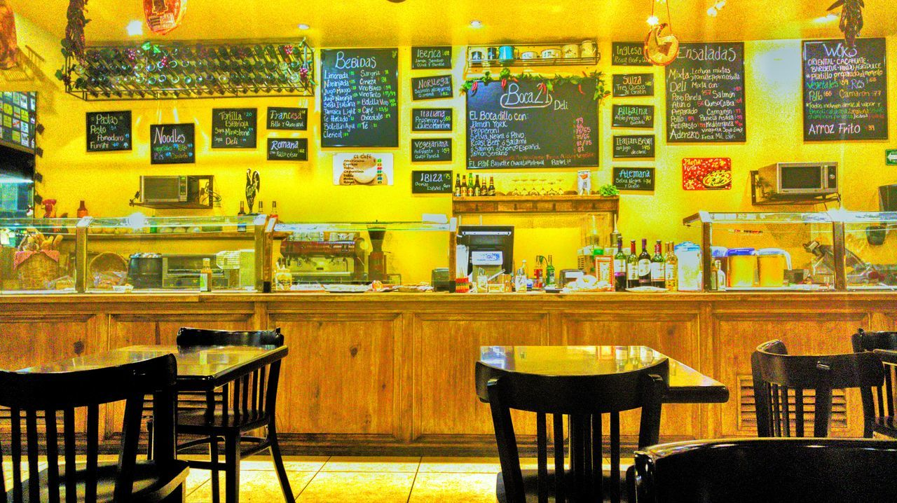 chair, table, restaurant, built structure, no people, indoors, cafe, yellow, bar - drink establishment, architecture, day, food