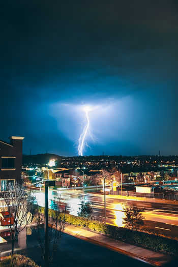 ELECTRIC Illuminated Night Architecture Building Exterior Lightning City Sky Cloud - Sky Power In Nature Storm Built Structure Thunderstorm Nature Cityscape Power Long Exposure Building No People Forked Lightning Outdoors Light