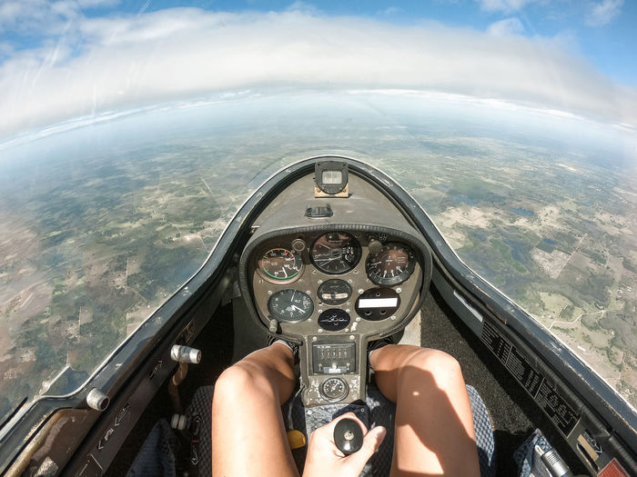 Piloting One Person Human Body Part Real People Transportation Sky Personal Perspective Mode Of Transportation Nature Cloud - Sky Airplane Day Vehicle Interior Outdoors Flying Piloting In Control Control Control Panel New Beginnings Courage