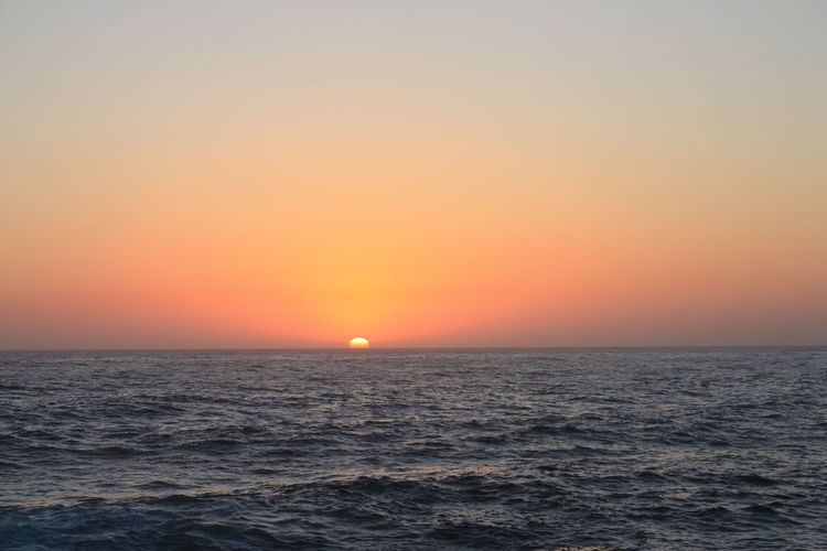 Rising sun Sunrise_Collection Beauty In Nature Clear Sky Copy Space Horizon Horizon Over Water Idyllic Nature No People Orange Color Outdoors Rippled Scenics Sea Sky Sun Sunrise Tranquil Scene Tranquility Water Waterfront Wave