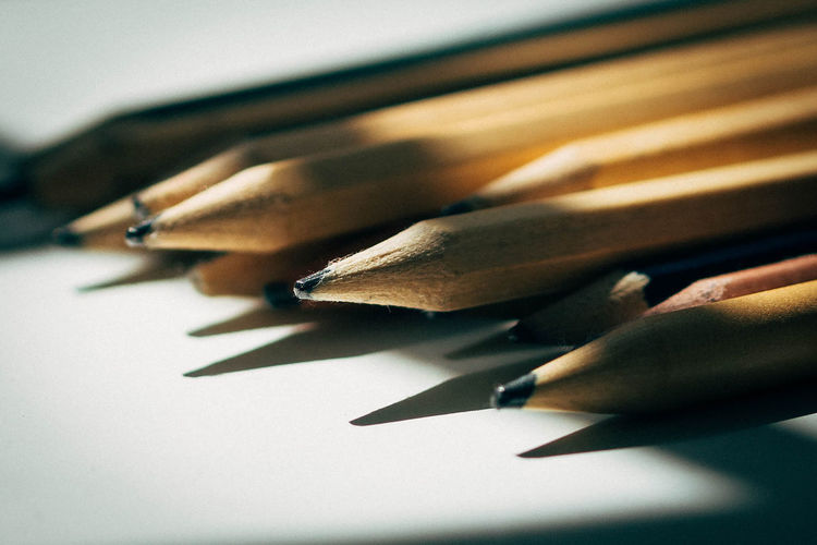 Close-up of pencils over white background