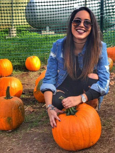 Pumpkin Halloween Vegetable Autumn Orange Color One Person Smiling Portrait Looking At Camera Day Front View Jack O' Lantern Fun Casual Clothing Field Only Women Confidence  Young Adult People Happiness