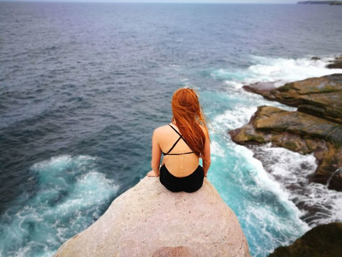 High angle view of woman on beach cliff