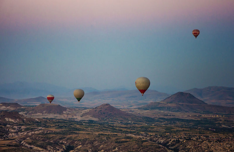 Ballooning Festival Beauty In Nature Day Flying Hot Air Balloon Landscape Mid-air Mountain Nature No People Outdoors Sky