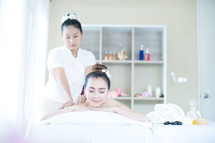Young woman during spa. woman relaxing in bed spa.