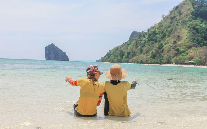2 Girl Krabi Thailand Adult Beach Beauty In Nature Bonding Couple - Relationship Day Horizon Over Water Land Leisure Activity Lifestyles Mature Men Men Nature Non-urban Scene Outdoors Positive Emotion Real People Rear View Scenics - Nature Sea Sky Togetherness Two People Water