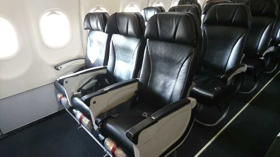Empty Black Seats In Airplane