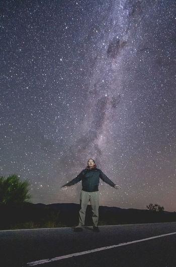 Full length of man standing against star field