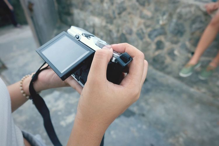 High angle view of woman holding camera