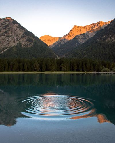 Rippled Lake Against Mountains