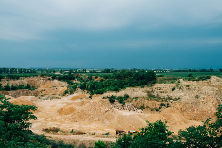 Minerals Beauty In Nature Day Environment Field Geology High Angle View Horizon Land Landscape Mine Nature No People Non-urban Scene Outdoors Plant Rural Scene Semi-arid Sky Stone Surface Mine Tranquility Truck Vehicle
