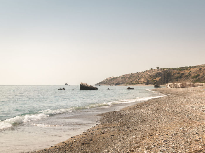 Aphrodite's Rock Beach Beauty In Nature Clear Sky Day Horizon Over Water Nature No People Outdoors Petra Tou Romiou Sand Scenics Sea Sky Tranquility Travel Destinations Vacations Water Water's Edge Wave The Great Outdoors - 2017 EyeEm Awards