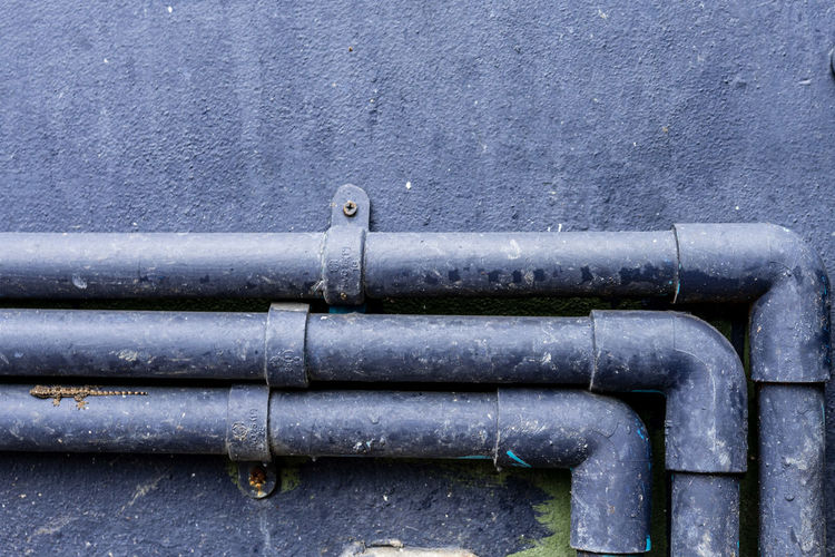 Close-up of pipes against wall