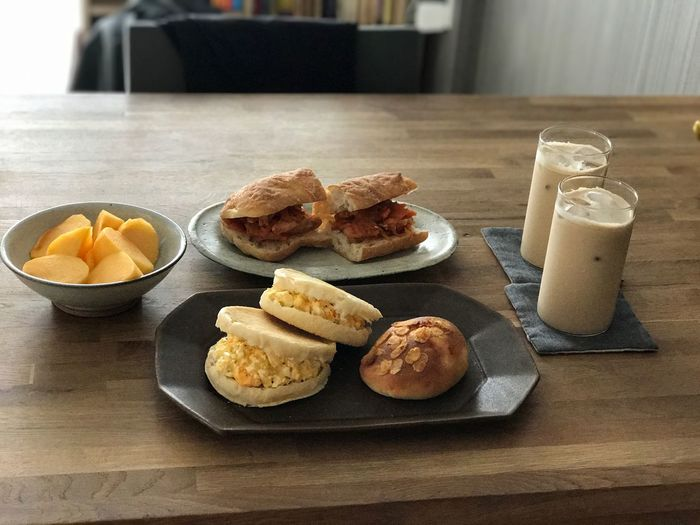 I woke up at 7:00 and ate breakfast. Indoors  Food Freshness No People Breakfast Homemade Food And Drink Bread Healthy Eating Table Drinking Glass Milk Drink Bun Comfort Food Ready-to-eat Day EyeEm Coffee Persimmon Egg