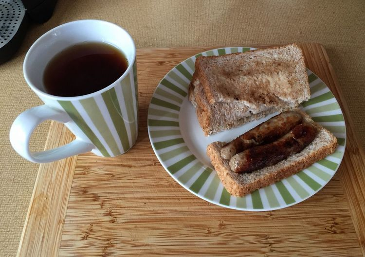 Cup Of Tea Mug Of Tea Tea Tea Time Toast🍞 Sandwich Brown Bread Sausage Sausage Sandwich Breakfast Snack Cutting Board
