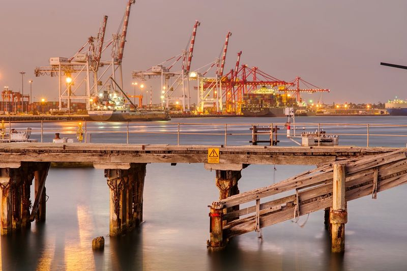 Fremantle harbour after sunset EyeEm Selects Water Crane - Construction Machinery Machinery Sky Pier Transportation Architecture Industry Sea Waterfront Built Structure Mode Of Transportation Nautical Vessel Reflection No People Business Freight Transportation Outdoors